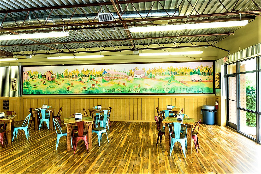 A mural at Simply Natural's Greenville location depicts the farm and creamery.