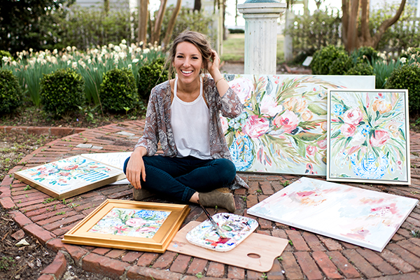 Brittany Rawls with her paintings