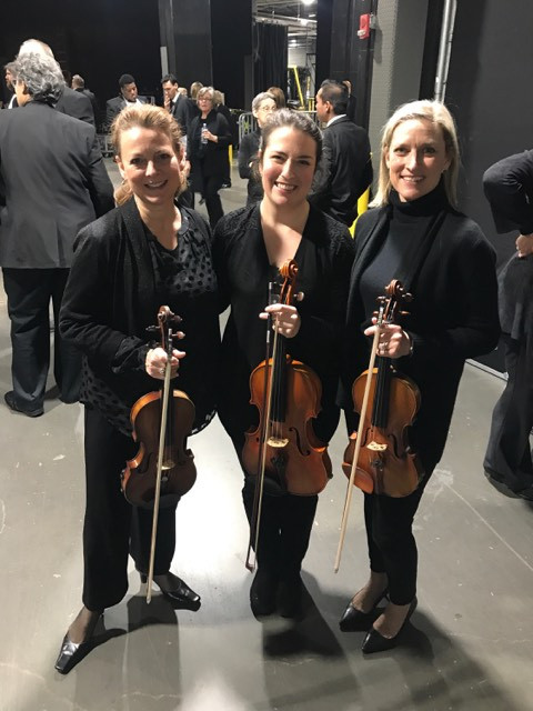 Violinists Pamela Bath Kelly, right, Kirsten Swanson and Andrea Bath Moore, who played in a Feb. 9 concert with Andrea Bocelli, are all students of Greenville Suzuki Violin teacher Joanne Bath.