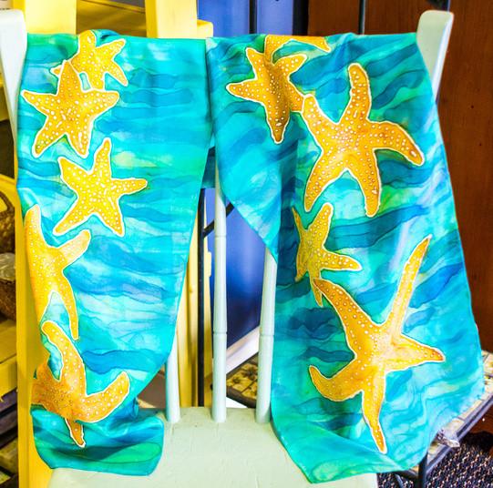 Handpainted starfish silk scarf, $70, Little Shoppes