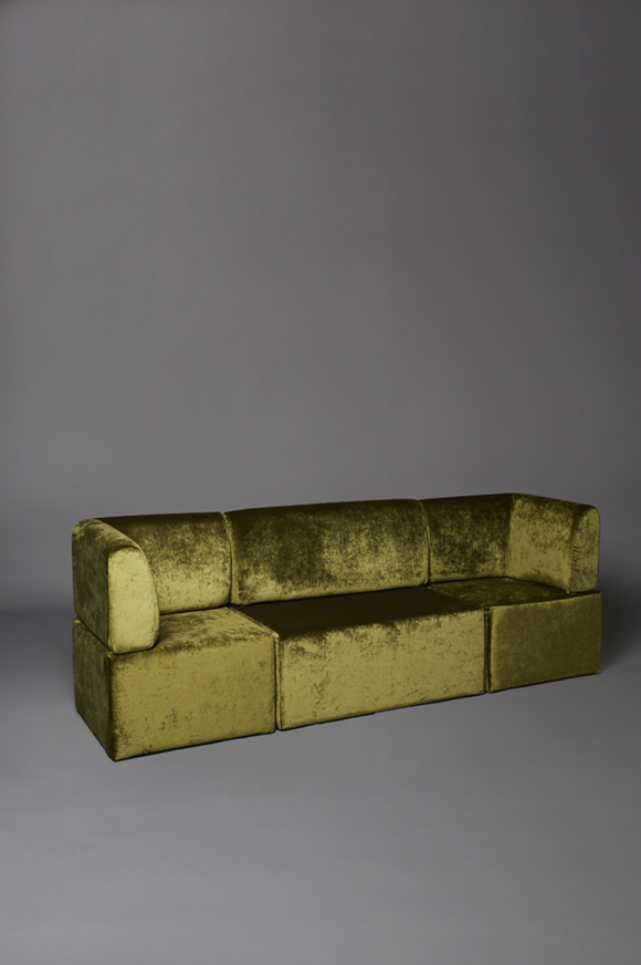 Green velvet straight back sofa