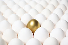 Golden-Egg-Standing-Out-from-a-Crowd-of-