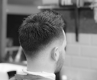 2016 mens hairstyle short skin fade,faded low textured scissor cut on top.Raikers barbers Blackpool.