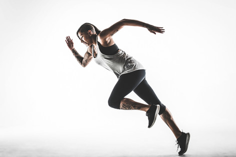Studio portrait of an athlete running