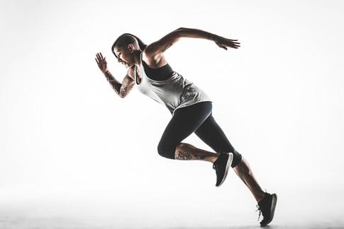 Studio portrait of an athlete running