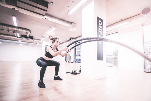 A woman exercings in workout clothing