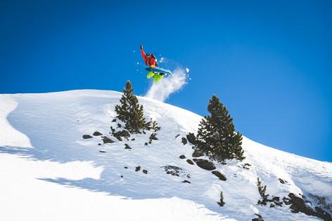 Snowboarder mid jump