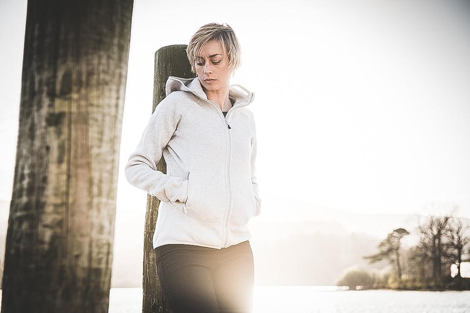Woman standing near lake