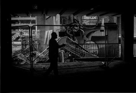 Sillouhette of man walking through city