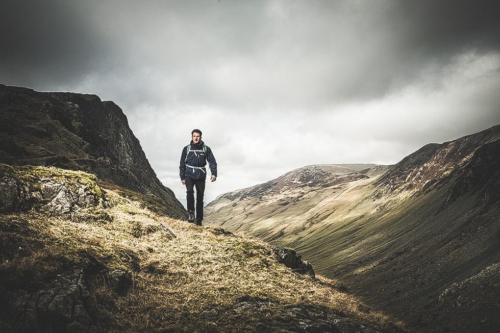 A man walks across a mountain
