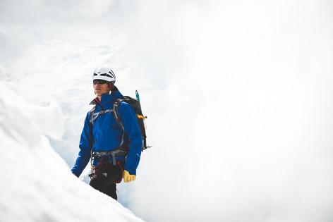 A climber scales a mountain