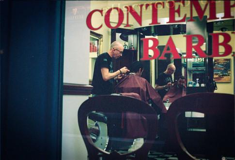 Shot through barber's window