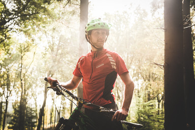 Portrait of a BMX rider in the woods