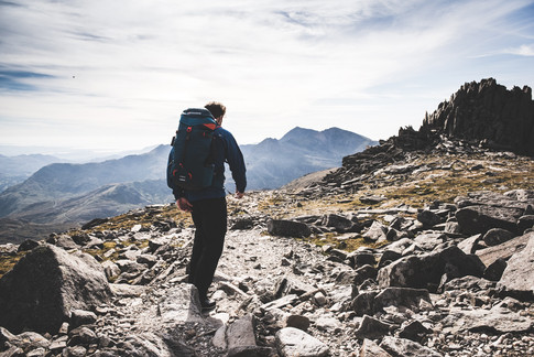 A man climbs a mountain