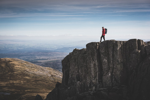 A man stands on a mountain top