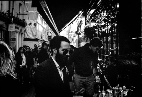 Street photo of crowds walking