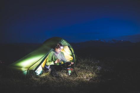 A man camping at night