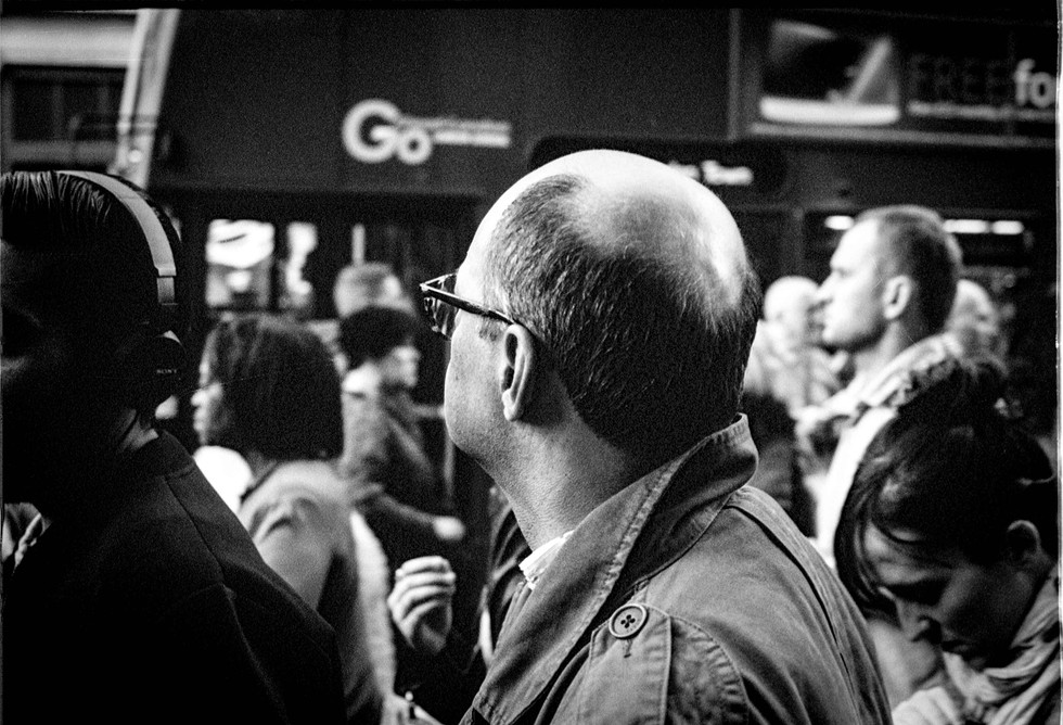 Street photography shot of man in crowd