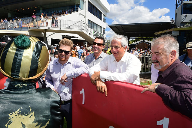 Viva Racing's Owners talking to winning jockey Ronnie Stewart after winning on Explosive One at Doomben