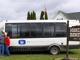 National Home visit inspires bus donation