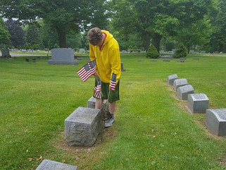 National Home Children Decorate Veteran Graves for Memorial Day