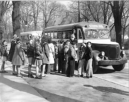 Historical image of children and school bus