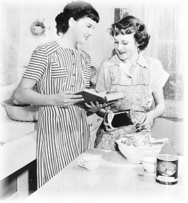 historicl photo of to girls cooking