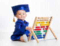Toddler in cap and gown