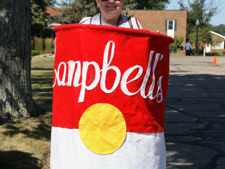 The End of an Era:  Dedicated Auxiliary Member Wears Campbell's Soup Costume for the Last Time.