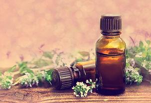 Thyme (thymus) essential oil on flowers