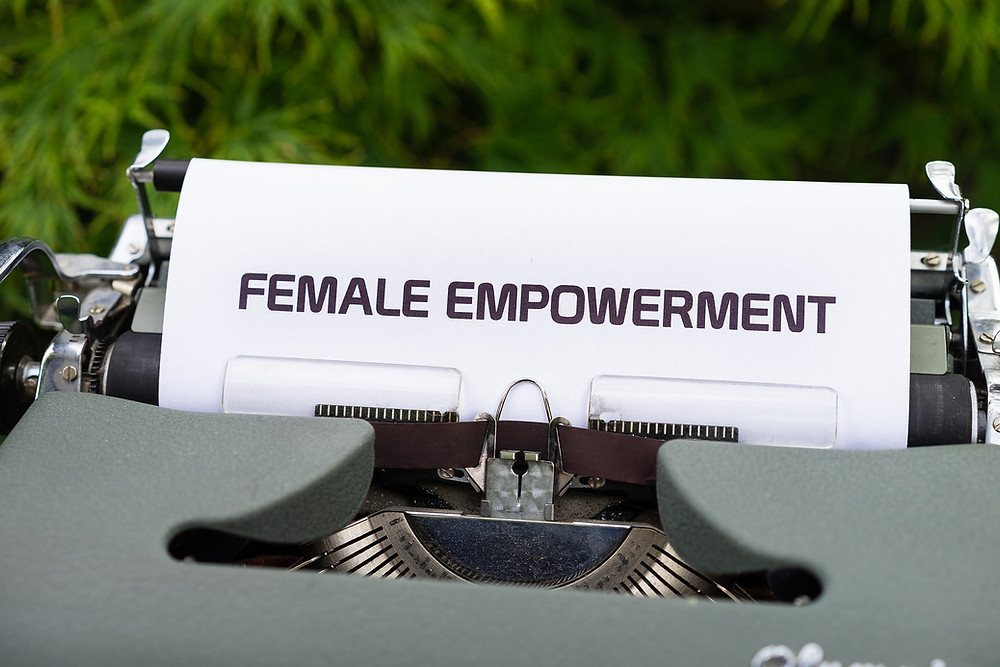 Typewriter with text Female Empowerment