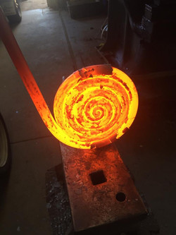 Forging a spiral for bollard light cap