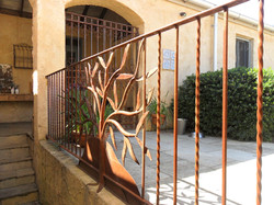 Rusty olive tree balustrade
