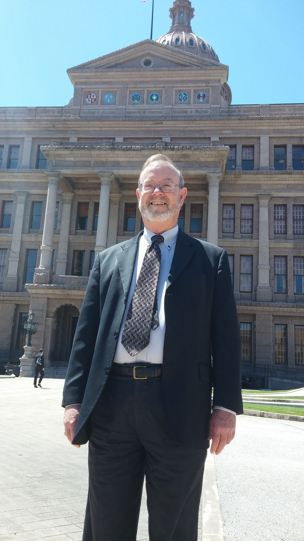Sam Drugan outside the Texas Capitol building.
