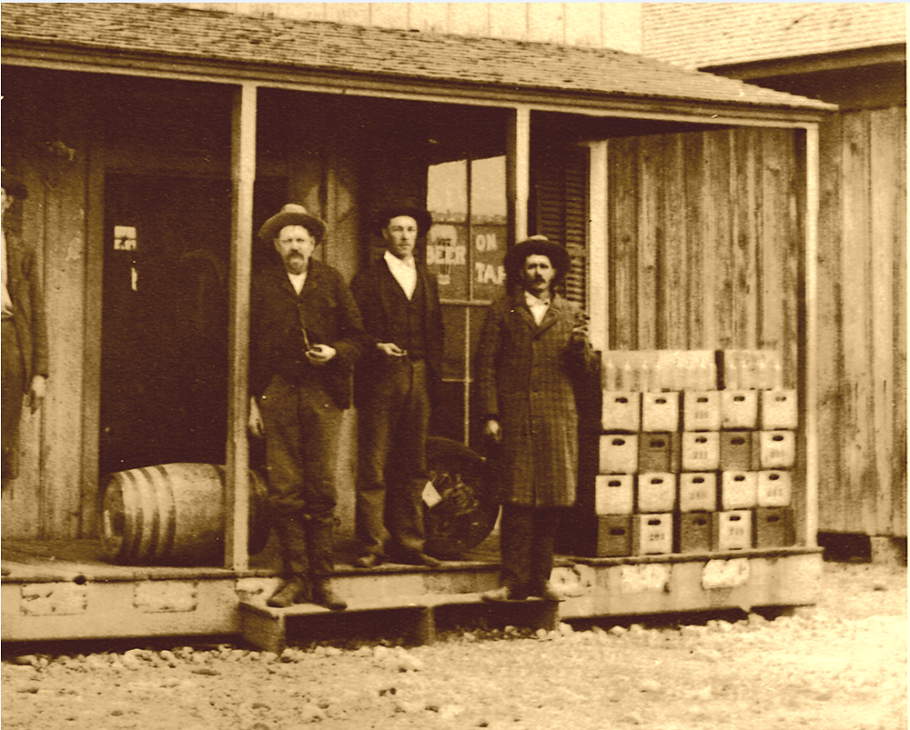 Men on porch of Budd's Saloon.PNG