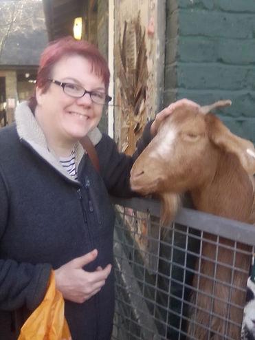 Becky with a goat a Vauxhall City Farm 1