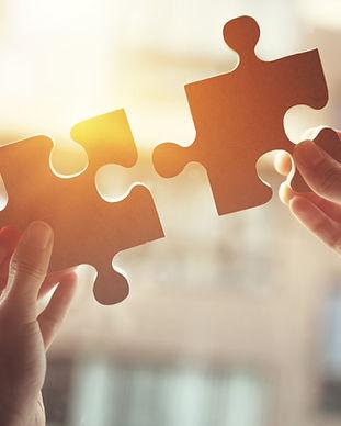 Closeup hand of woman connecting jigsaw