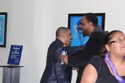 Michael greets guest