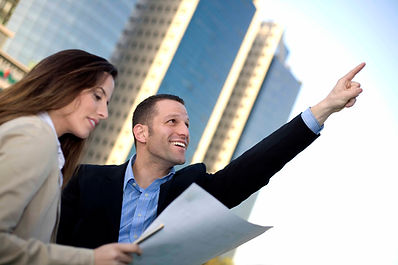 "<img src=""Plan & Vision.jpg"" alt=""a woman reading their vision and business plan on paper while a man points to the sky smiling"">"