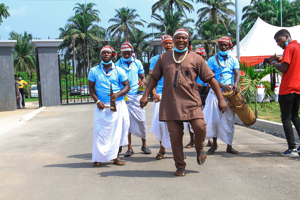 Traditional Imo State performers greeting guests at the gate of AIHWA's Hope Center.