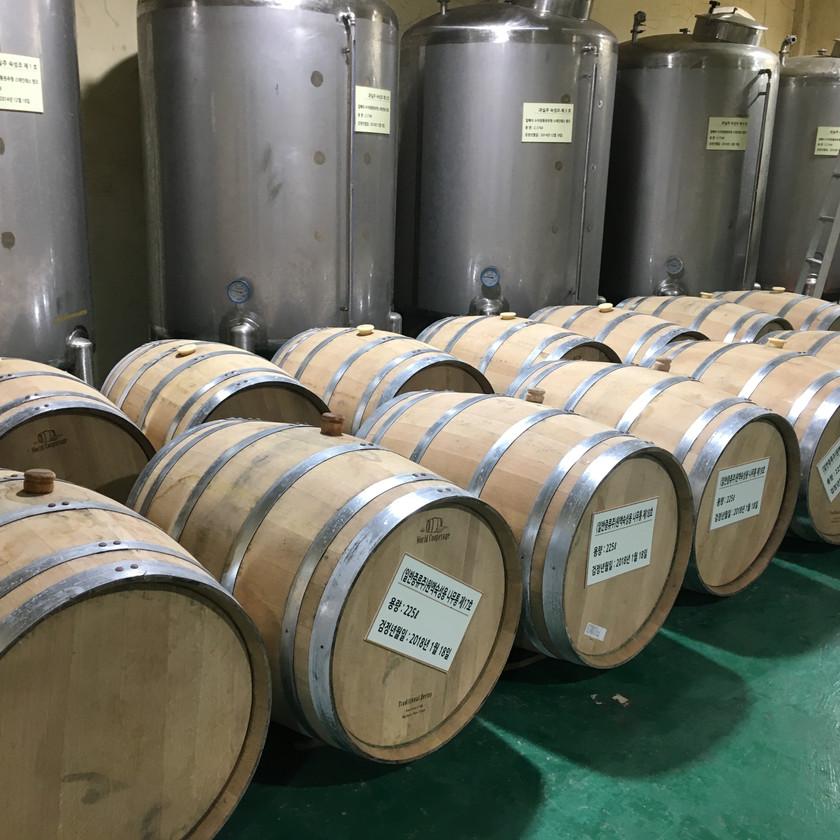 The oak casks used to age Jeju citrus Hallabong wine