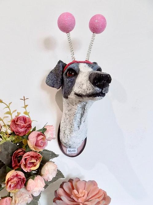 Deeley Bopper wearing Greyhound sculpture named Myrtle