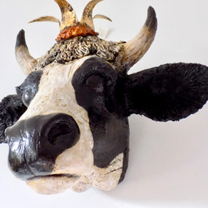 Crown wearing cow sculpture