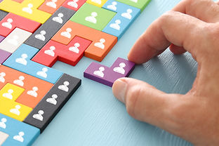 image of tangram puzzle blocks with people icons over wooden table ,human resources and ma