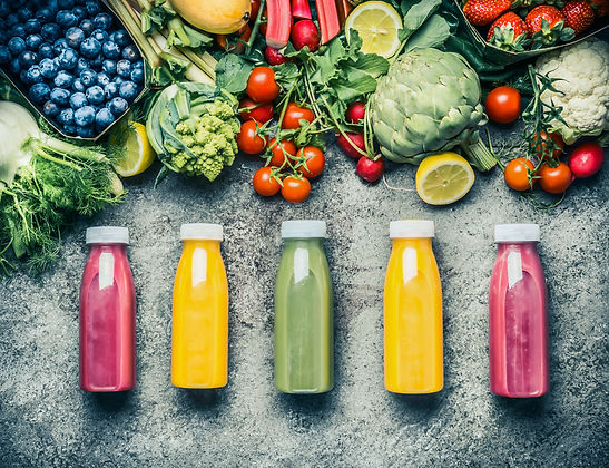Variety  of colorful Smoothies or juices bottles beverages drinks with various fresh ingre