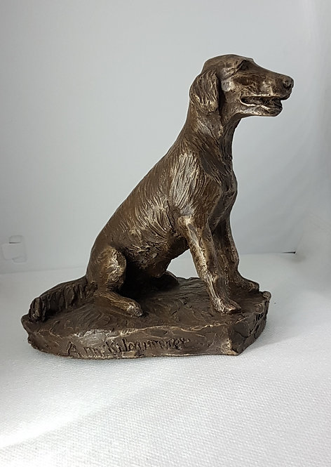 Flatcoated Retriever puppy in sitting position in cold cast bronze by Ann Kilminster