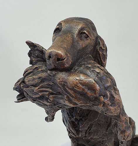 Flatcoat Retriever with Duck Sculpture