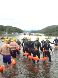 Swimmers making their way into the water at the start