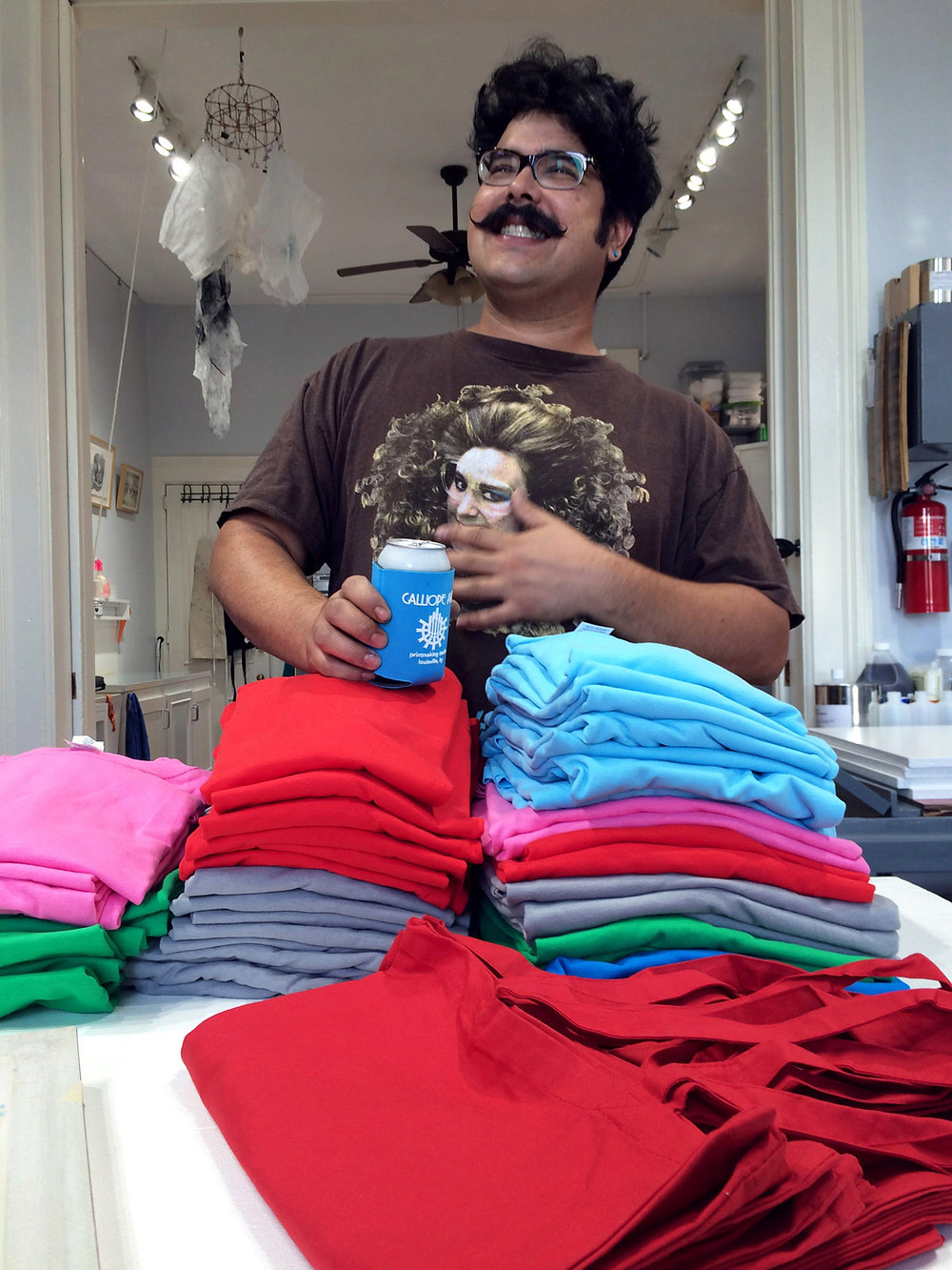 Rudy and T-shirts, in preparation for our Grand Opening