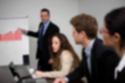 A male instructor and students at an ISO 27001 training class